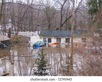 SOUTHBURY, CONNECTICUT - MARCH 7: Flooding house along the Pomperaug River on March 7, 2011 in Southbury, CT. The neighborhood is being evacuated due to the vast rainfall and the rising river.