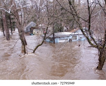 SOUTHBURY, CONNECTICUT - MARCH 7: Submerged house along the Pomperaug River on March 7, 2011 in Southbury, CT. The neighborhood is being evacuated due to the vast rainfall and the rising river.