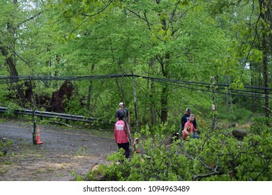 Southbury, Connecticut/USA - May 15, 2018: EF -1 tornado takes down trees and power lines across portions of the state. Neighbors work together to clear the roads.