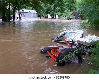 SOUTHBURY, CT, USA - AUGUST 28: The Pomperaug River rises due to Hurricane Irene and floods a low lying neighborhood on Aug. 28, 2011 in Southbury, CT. This is the 4th highest crest in the history of the Pomperaug River.