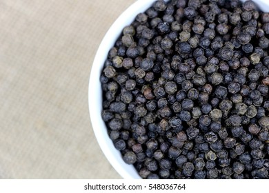 Southeast Asia Whole Black Pepper in White Container.