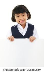 Southeast Asian schoolgirl holding a white board