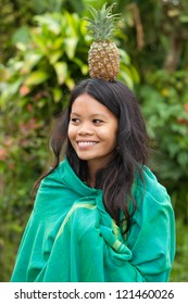 South-east asian woman with pineapple on her head