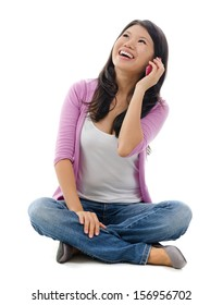 Southeast Asian woman talking on smartphone, full body sitting over white background
