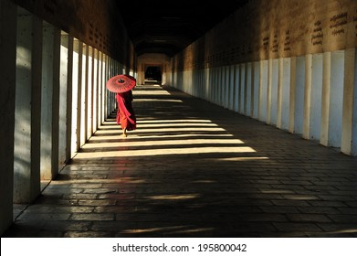 Southeast Asian young little Buddhist monks walking morning alms in bagan, Myanmar