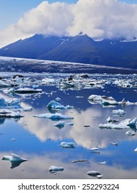 South-east Iceland in July. Transparent icebergs and ice floes in the Ice Lagoon Jokulsarlon