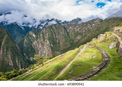 Southeast terraces of Machu Picchu used for agriculture with later afternoon sunshine