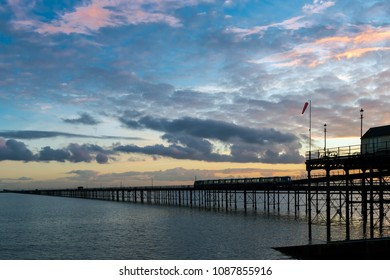 Southend pier with train in evening