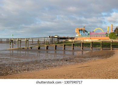 Southend-on-Sea, Essex / England - 02/07/2019: Jubilee beach with Southend Pier and Adventure Island in the background