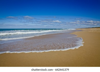 Southerly Point - Mainland Australia's southern beaches. Wave line on the sand, blue sky with little white clouds.