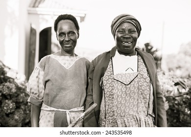 Southern Africa - March 27, 2012: Two women stand side by side in house clothing