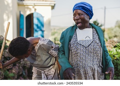 Southern Africa - March 27, 2012: Two women joking in a garden