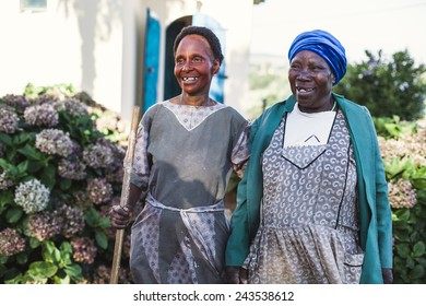 Southern Africa - March 27, 2012: Two women standing in a garden
