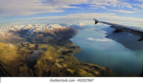 The Southern Alps from Up the Air is a glimpse of the nascent beauty of the South Island. This is a shot taken near Queenstown Airport .