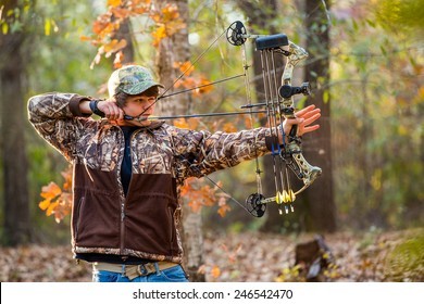 4740e5b37df5 southern american teen boy out in the woods bow hunting for deer