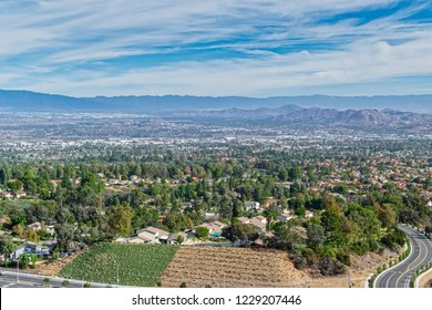 Southern California fall day with houses in valley and beautiful sky for copy text