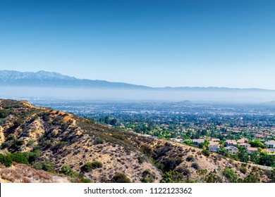 Southern California houses in summer sun and morning haze in inland empire