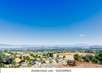 Southern California inland area looking south east on warm fall day with Santa Ana winds blowing over the cities and room for copy space in  the blue sky
