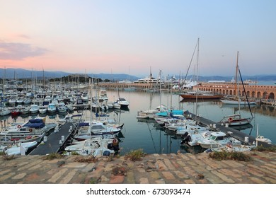 Southern France, landscape of French Riviera. Antibes, view of the old port and yachts, sunset
