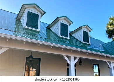 a southern house roof line with 3 gables and green shingles