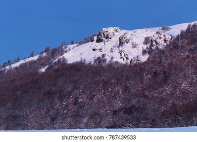 Southern side of the Wrekin Hill rocky sumit covered in snow at winter.
