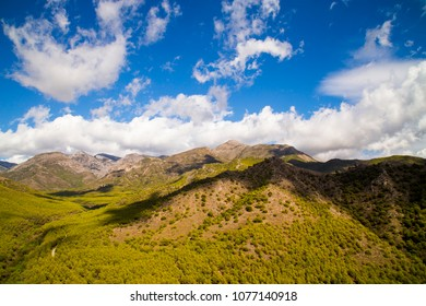 Southern Spanish mountains under a cloud torn blue sky