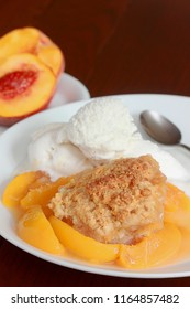 Southern style peach cobbler made with the freshest fruit of the season, just like your parents or grandparents baked with flaky biscuits served with a side of vanilla ice cream