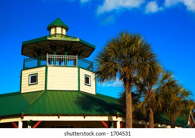 Southern style watch tower next to palm trees.