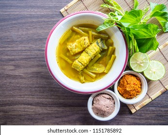 Southern Thai  food, Spicy Sour Yellow Curry with Sea Bass and Thai Water Spinach, Sour soup made of Bilimbing and lime juice. decorate with curry paste,shrimp paste.