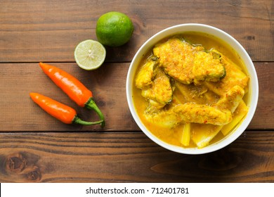 Southern Thai Spicy Sour Yellow Curry with Sea Bass and Coconut Shoots, Sour soup made of Tamarind Paste or Turmeric.