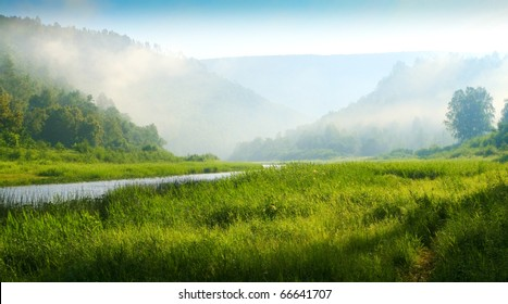Southern Urals. Mountains and river. Sunrise