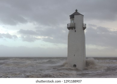 Southerness Lighthouse being battered by a heavy storm. Dumfriesshire, Scotland.