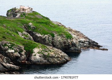 The southernmost point of Russia, Huge rocks on the ocean, sea summer landscape, old stone building on a high cliff, Gamova lighthouse, Russia, Primorsky Krai, Peter the great Bay, Babkin Cape.