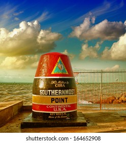 Southernmost Point sign in Key West, Florida. Beautiful seascape with sunset sky.