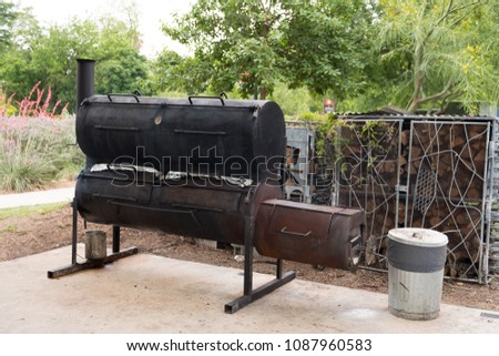 Southerny style smoker bbq in Texas where the cook is smoking some meat for a big dinner celebration.