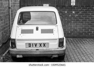 Southhampton, United Kingdom - April 24, 2019: Vintage white Fiat 126 hatchback stands on a private parking, rear view. Black and white photo