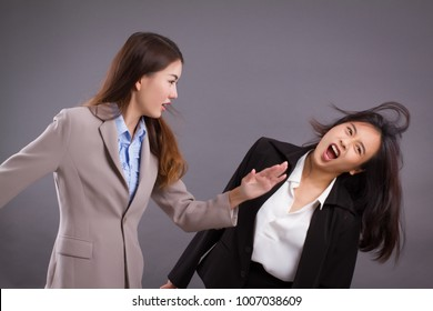 southpaw business woman beating surprised impact slap to competitor