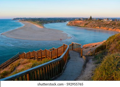 Southport Beach steps and Onkaparinga River estuary at Port Noarlunga South, in the southern suburbs of Adelaide, South Australia. Taken during the golden hour at sunset