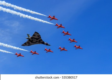 SOUTHPORT, ENGLAND, SEPTEMBER 19, 2015 The RAF Avro Vulcan Bomber XH558 with The Red Arrows Vulcan tribute formation to celebrate the Vulcans last year of flight