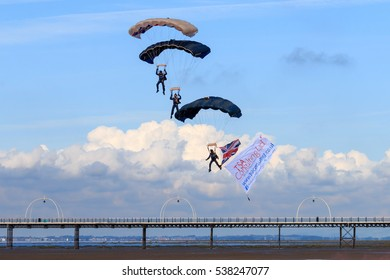 SOUTHPORT, ENGLAND, SEPTEMBER 19, 2015 Three of the Tigers Freefall ParachuteTeam members paragliding in to  land in front of the crowd at the airshow