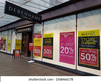 Southport, Lancashire. UK 11/23/2019  Debenhams store front with window displays announcing the store is to close and advertising money off sales across the shop. This is one of 22 stores to close.