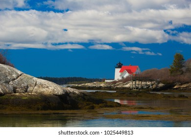 Southport, Maine / USA - April 23, 2017: Hendrick's Head Lighthouse  on bright sunny day along coastal Southport, Maine