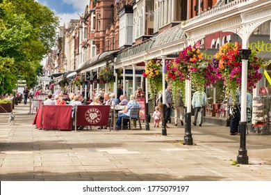 Southport, Merseyside, UK - July 14 2019: Lord Street, the seaside town's main shopping street, with a Costa Coffee Shop, lots of people sitting at tables outside. Beautiful old heritage buildings.