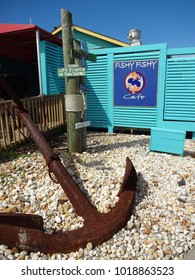 SOUTHPORT, NC - APRIL 2015: Large anchor outside the Fishy Fishy Cafe down by the harbor in Southport, North Carolina