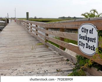 Southport, NC, USA - July 28, 2014: City of Southport City Docks sign and entrance. Entry and sign to wooden Southport City Docks on a N Carolina summer day