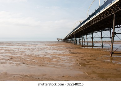 Southport Pier during low tide.