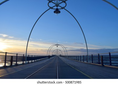 Southport pier with sunset background.