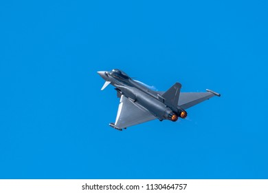 SOUTHPORT, UK JULY 8 2018:  An EU2000 Eurofighter Typhoon performing a flight display in clear blue skies