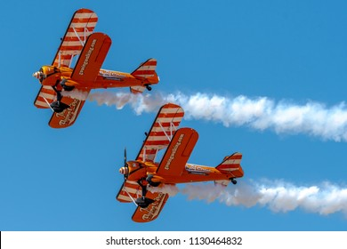 SOUTHPORT, UK JULY 8 2018: Two world famous Aerosuperbatics Wing Walkers from The Flying Circus thrill the crowds in the skies above Southport Beach for the annual Air show