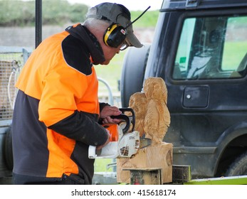 Southsea, England 2nd May 2016. A man carves wooden sculptures using a chainsaw at the Rural and seaside show 2016.